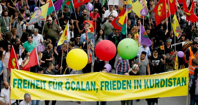 A group of PKK supporters march with a banner reading Freedom for Öcalan, peace in Kurdistan on the Unlimited solidarity instead of G20 demonstration during the G20 Summit in Hamburg, Germany, July 8, 2017.