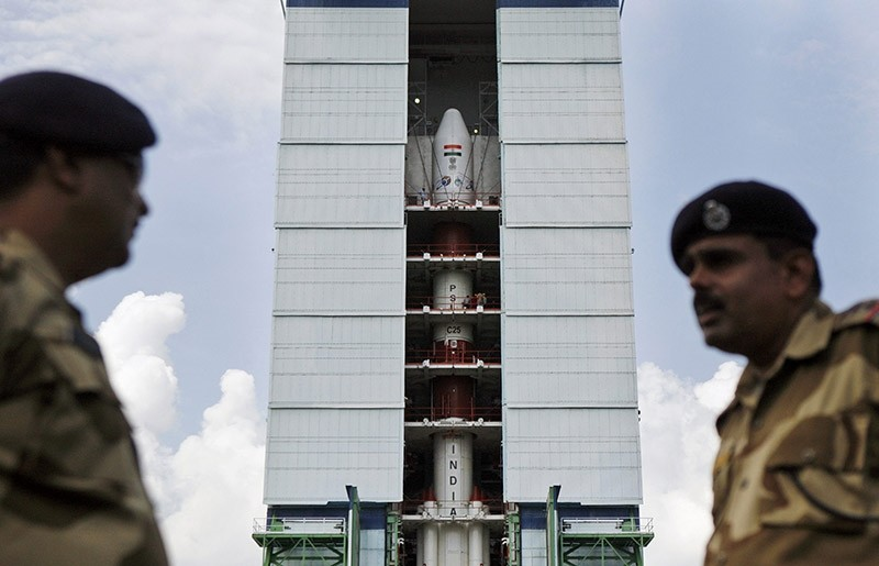 Central Industrial Security Force (CISF) personnel stand guard near the Polar Satellite Launch Vehicle at Sriharikota, in the southern Indian state of Andhra Pradesh. (AP File Photo)