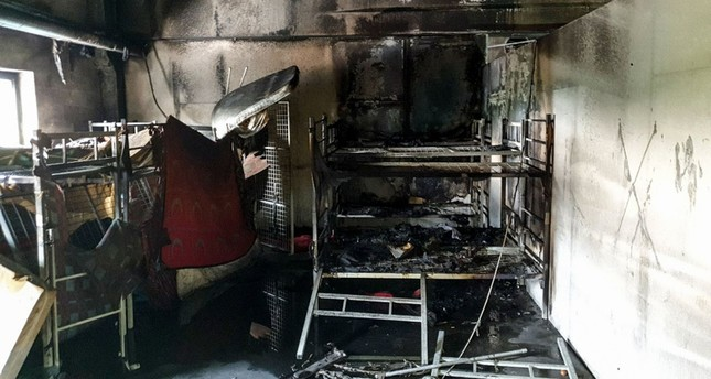 A picture taken on June 1, 2019 shows the aftermath of a fire in a shelter for migrants in the town of Velika Kladusa. (AFP Photo)