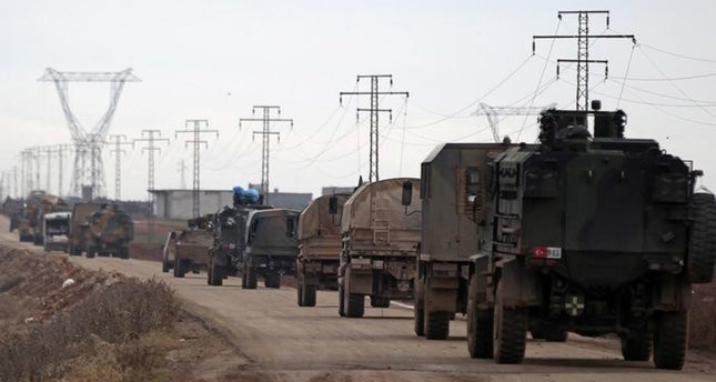 In this file photo, a column of Turkish military vehicles are seen advancing towards the town of Al-Bab in northern Syria. (AA Photo)