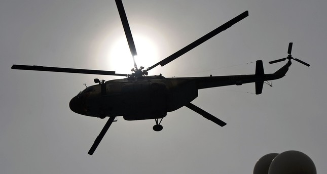 This file photo taken on March 23, 2014 shows a Pakistani Air Force Mi-17 helicopter flies over the Presidential Palace during a parade marking the country's National Day in Islamabad. (AFP Photo)
