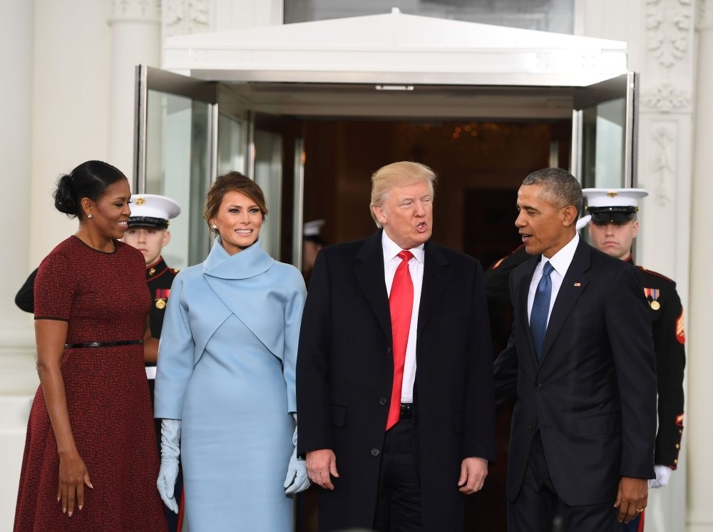 From left to right, then-first lady Michelle Obama, Melania Trump, President-elect Donald Trump and then-President Barack Obama meet at the White House, Washington, Jan. 20, 2017.