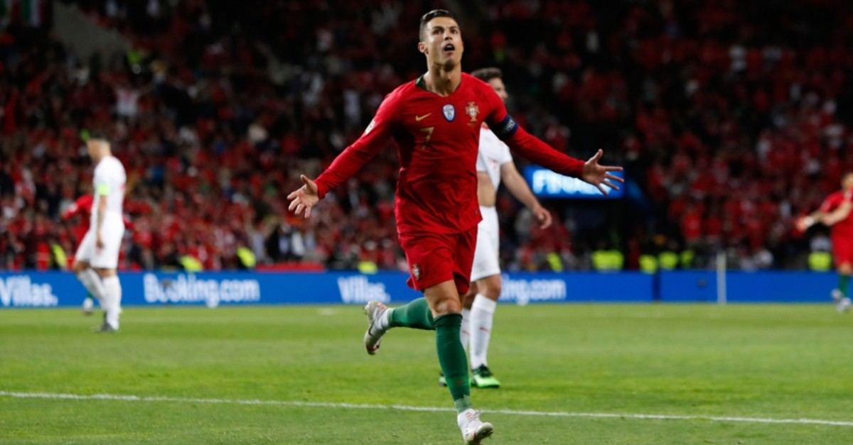 Portugal's Cristiano Ronaldo celebrates after scoring his side's third goal during the UEFA Nations League semifinal soccer match between Portugal and Switzerland at the Dragao stadium in Porto, Portugal, Wednesday, June 5, 2019. (AP Photo)
