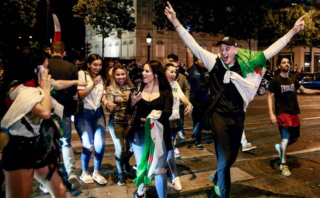 Algeria supporters celebrate after Algeria won the 2019 Africa Cup of Nations (CAN) semi-final football match against Nigeria, on the Champs-Elysee avenue in Paris, July 14, 2019. (AFP Photo)