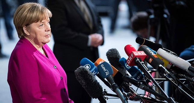 German Chancellor Angela Merkel gives a statement prior to a meeting with the leaders of the conservative CDU/CSU union and the social democratic SPD party in Berlin. AFP Photo