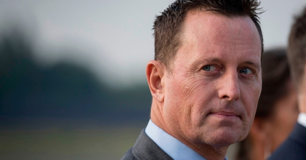 In this file photo taken on May 30, 2019 US ambassador to Germany Richard Grenell awaits the arrival of US Secretary of State Mike Pompeo (not in frame) at Tegel airport in Berlin. (AFP Photo)