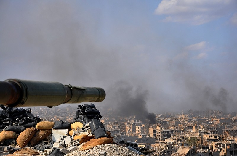 Smoke billows from the eastern city of Deir el-Zour during an operation by the Assad regime against Daesh terrorist group, Nov. 2, 2017, Deir el-Zour, Syria. (AFP Photo)
