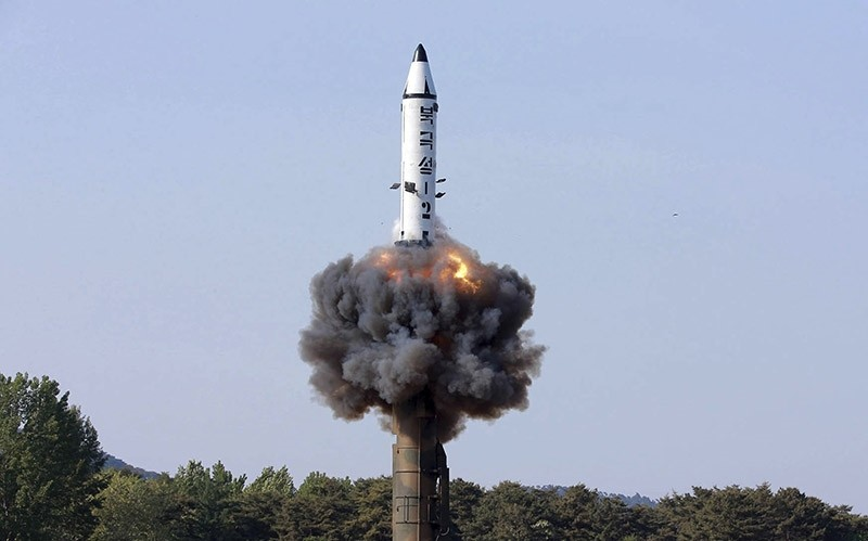 In this undated file photo distributed by the North Korean government on May 22, 2017, a solid-fuel ,Pukguksong-2, missile lifts off during its launch test (AP Photo)