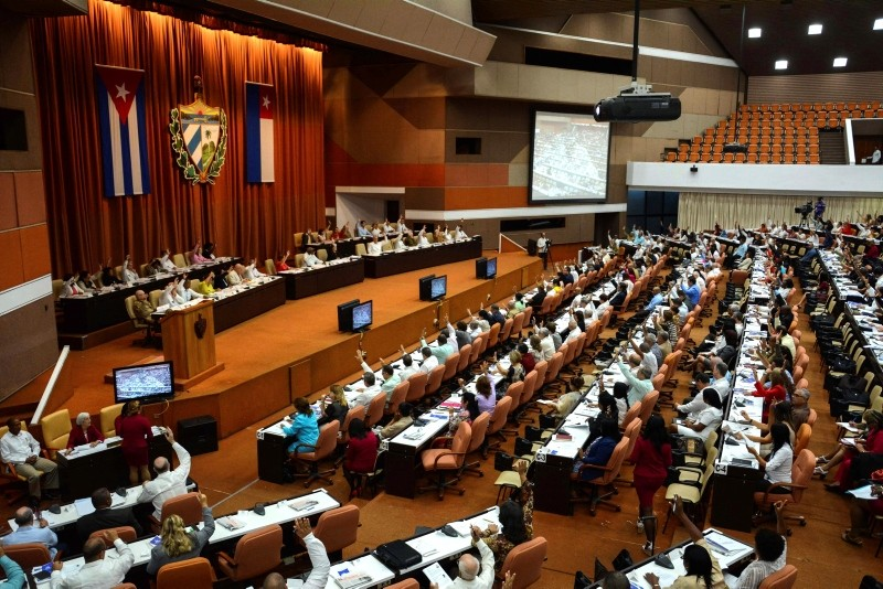 Members of the National Assembly vote during a session to update the current Constitution and present the new Council of Ministers, in Havana, Cuba, Saturday, July 21, 2018. (AP Photo)