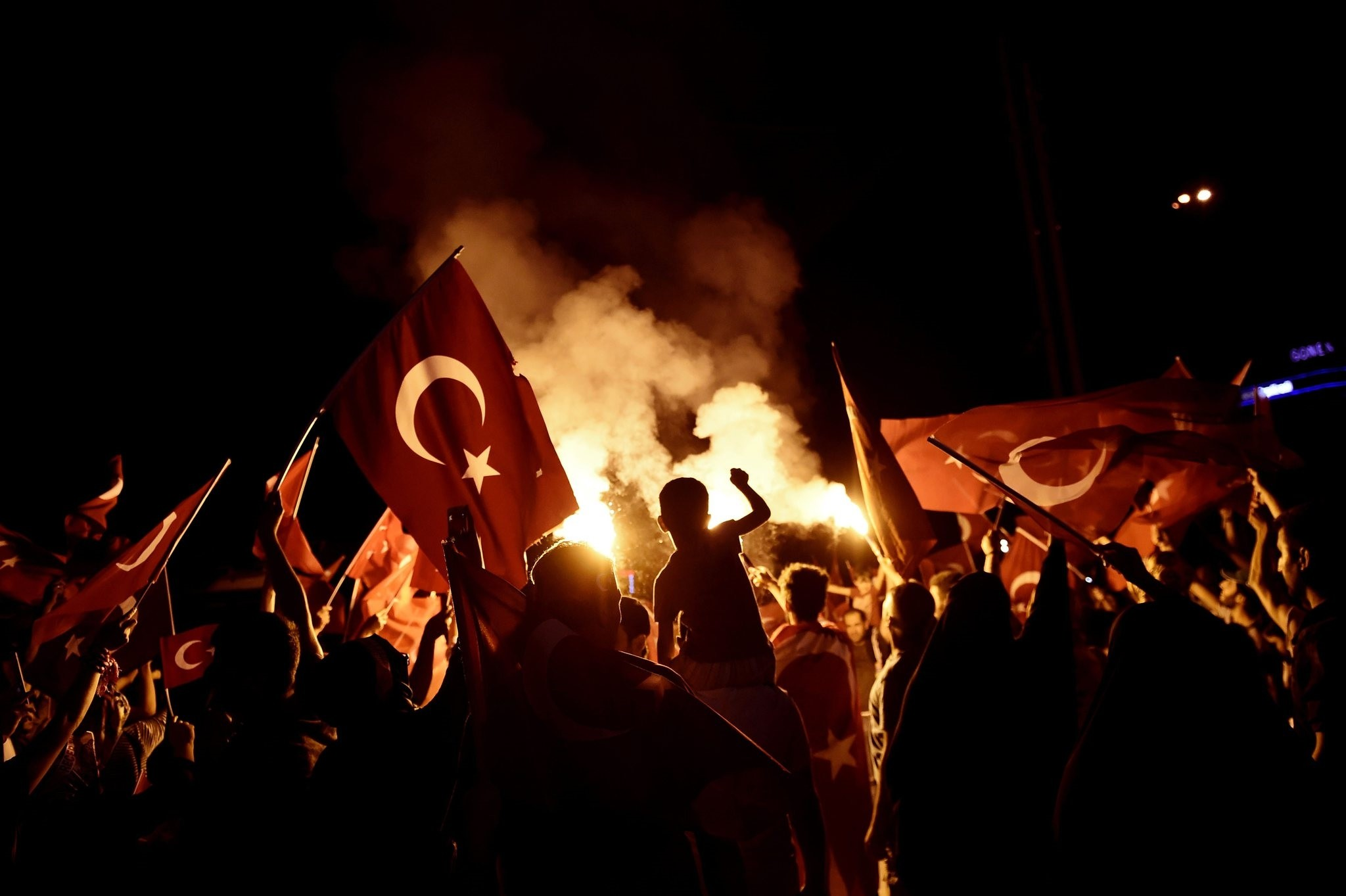 People waving Turkish flags during a rally against the failed coup attempt, Taksim Square, Istanbul, July 18, 2016.