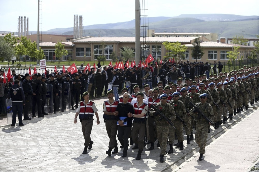 Gendarmerie troops escort the defendants to the courtroom in the main trial on the July 15 coup bid in Ankara.
