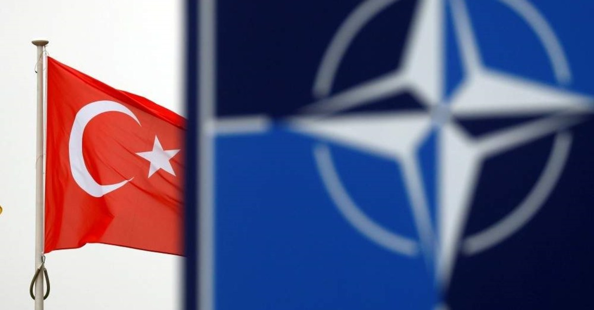 A Turkish flag flies next to the NATO logo at the alliance's headquarters in Brussels, Belgium, Nov. 26, 2019. (Reuters File Photo)