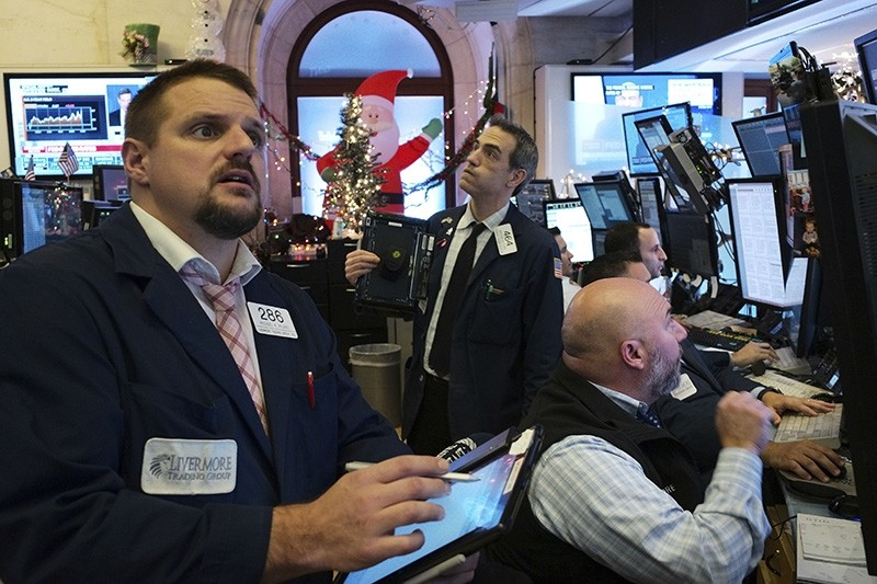 Traders with Livermore Securities at the New York Stock Exchange follow the news from the Federal Reserve Board of a rate increase, Wednesday, Dec. 19, 2018. (AP Photo/Mark Lennihan)
