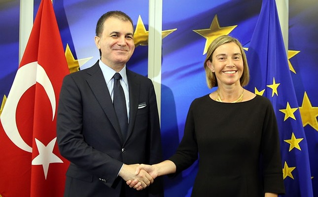 EU Minister Ömer Çelik (L) shakes hands with EU foreign policy chief Federica Mogherini prior to a meeting in Brussels, May 10, 2017. (AA Photo)