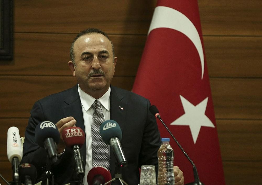Foreign Minister Mevlu00fct u00c7avuu015fou011flu speaks at the Atatu00fcrk International Airport ahead of his trip to New York in Istanbul, Turkey, Dec. 20, 2017. (AA Photo)