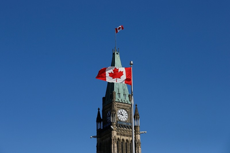 A Canadian flag flies in front of the Peace Tower on Parliament Hill in Ottawa, Ontario, Canada, March 22, 2017 (Reuters Photo)