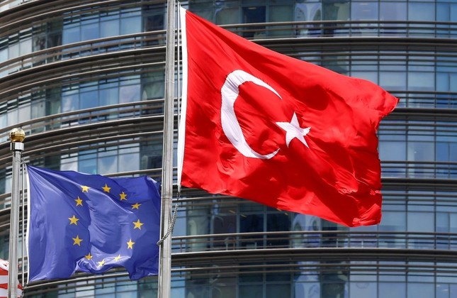 Turkish and European Union flags fly outside a hotel in Istanbul, May 4, 2016.
