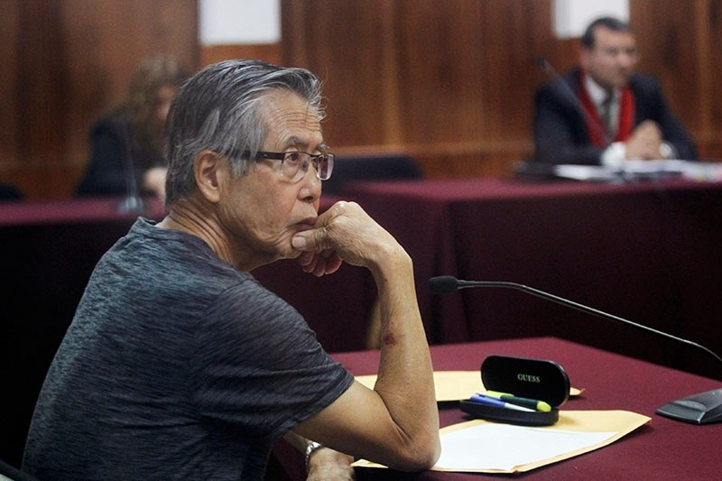 Peru's former President Alberto Fujimori sits in court during the sentencing in his trial on charges of embezzling state funds to manipulate the media during his tenure as president, in Lima, Peru January 8, 2015. (Reuters Photo)