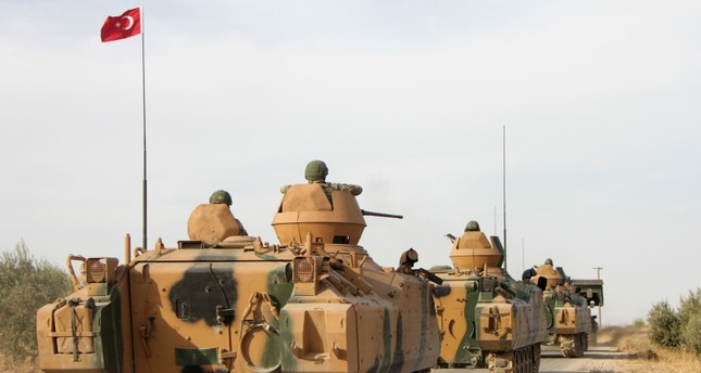emTurkish soldiers are trasported in armoured personnel carriers through the town of Tukhar, north of Syria's northern city of Manbij, on October 14, 2019 AFP Photo/em