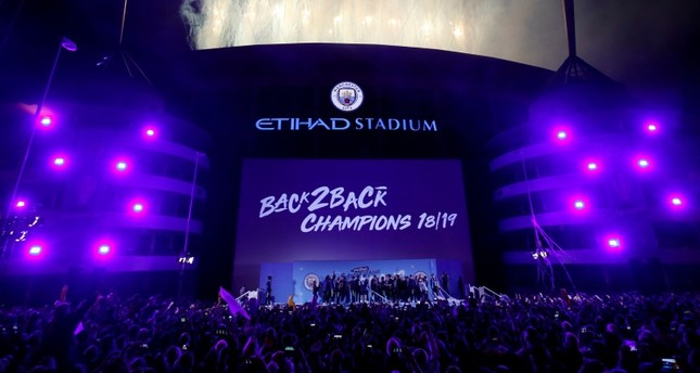 Manchester City fans and players celebrate the team's Premier League championship at the Etihad Stadium in Manchester, U.K., May 12, 2019. (Action Images via Reuters/Carl Recine)