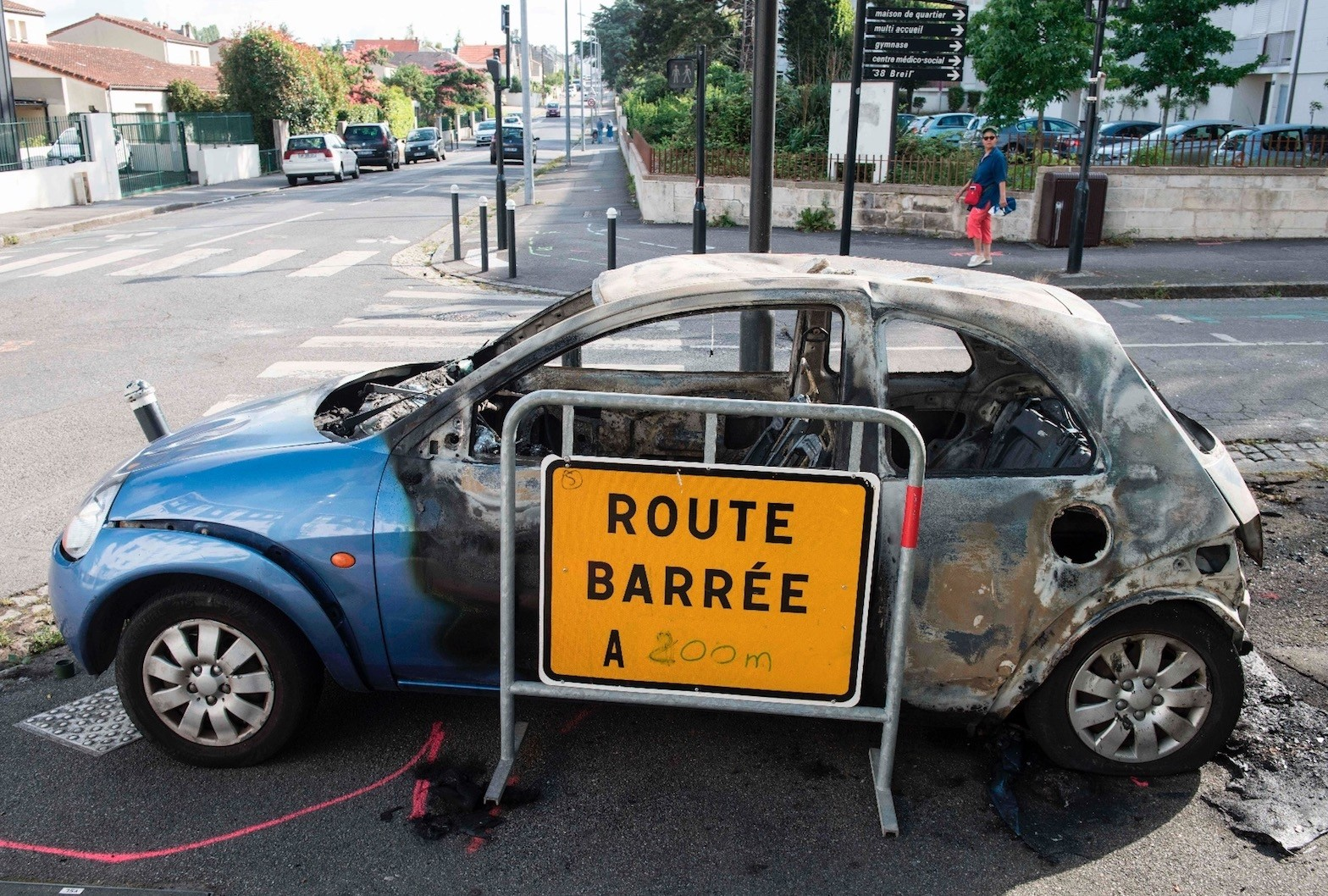 A burned car following clashes between groups of young people and the police in the Breil neighborhood of Nantes, July 4.