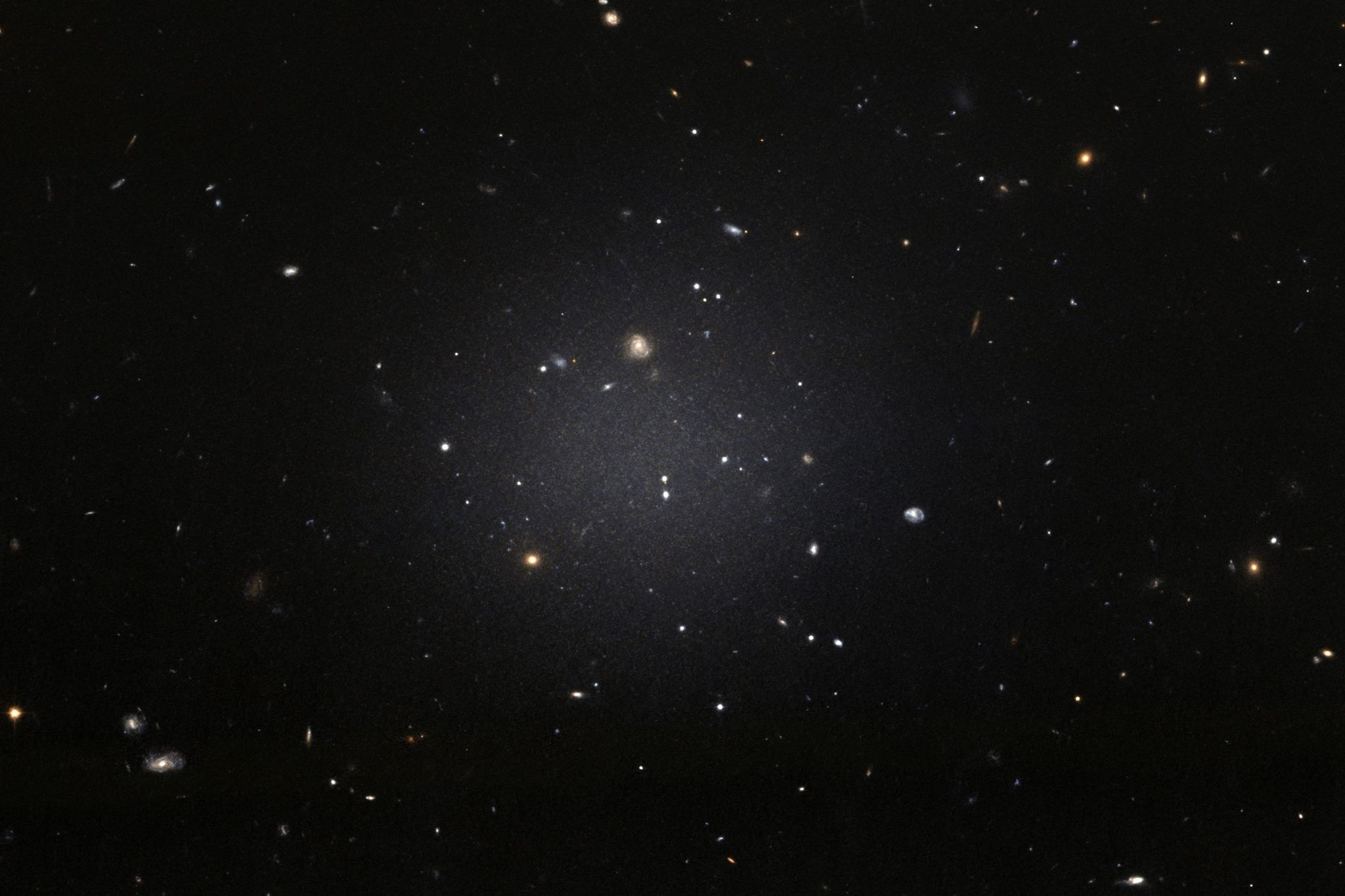 This handout image released by the European Space Agency (ESA) from the NASA/ESA Hubble Space Telescope shows the NGC 1052-DF2 galaxy which is missing most, if not all, of its dark matter. (AFP Photo)