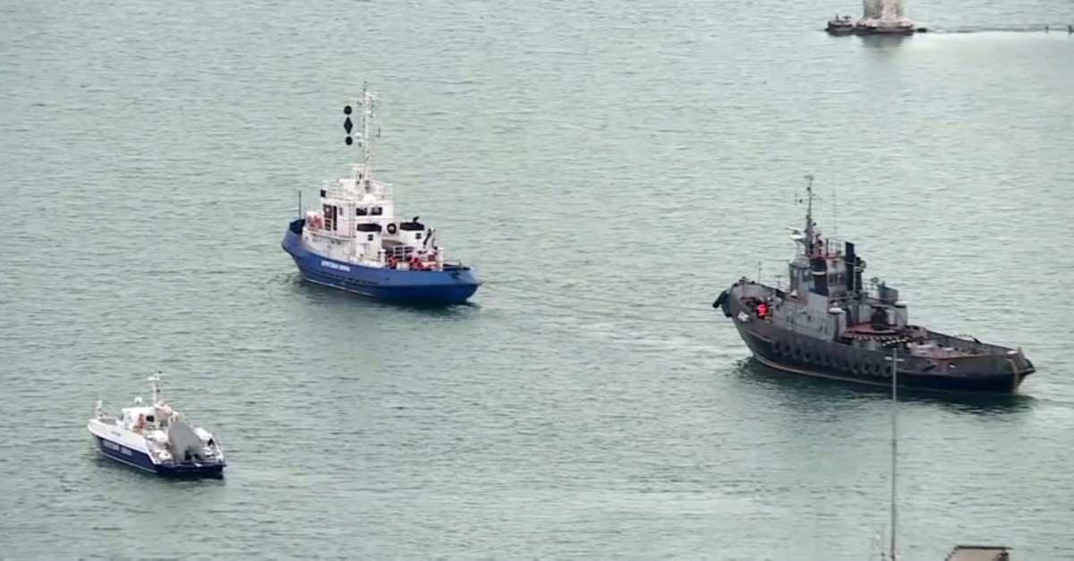 This video grab provided by the Krym 24 tv station via AP Television shows a seized Ukrainian ship, right, is towed by a Russian coast guard boat out of the port in Kerch, Crimea, Sunday, Nov. 17, 2019. (Krym 24 tv station via AP Television)