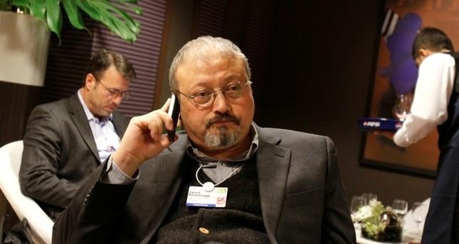 In this Jan. 29, 2011 photo, Saudi Arabian journalist Jamal Khashoggi speaks on his cellphone at the World Economic Forum in Davos, Switzerland. (AP Photo)