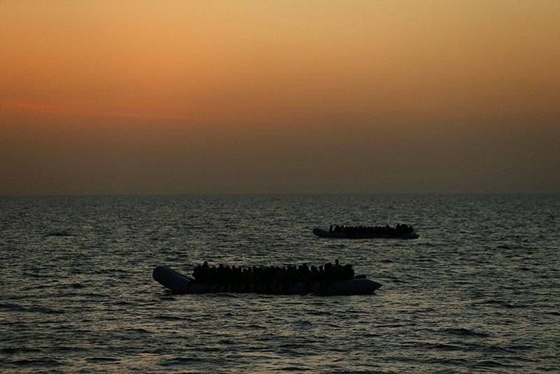 Migrants awaiting rescue on rubber dinghies are seen from the Malta-based NGO Migrant Offshore Aid Station (MOAS) ship Phoenix in the central Mediterranean in international waters off the coast of Sabratha in Libya, April 15, 2017 (Reuters Photo)