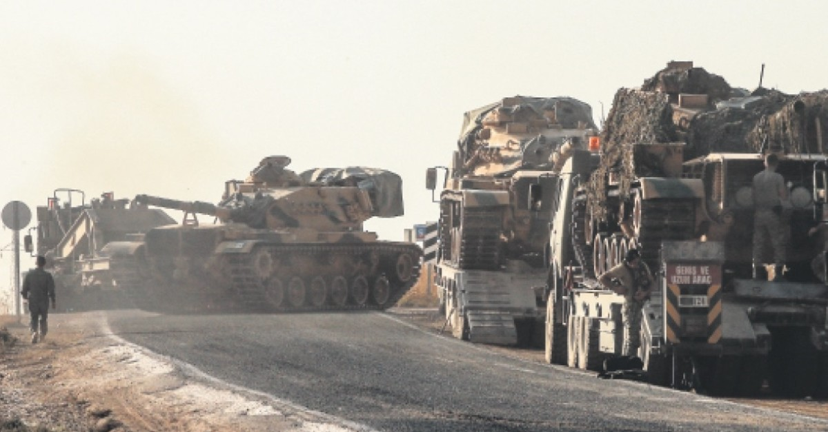 A Turkish tank moves toward the border with Syria in southeastern u015eanlu0131urfa province to join Operation Peace Spring, Oct. 14, 2019.
