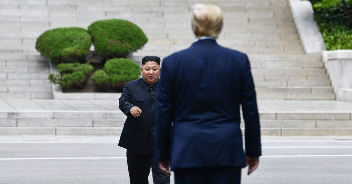 In this file photo on June 30, 2019, North Korea's leader Kim Jong Un walks to greet U.S. President Donald Trump at the Military Demarcation Line that divides North and South Korea, in the Joint Security Area (JSA) of Panmunjom in the Demilitarized Zone (DMZ). (AFP Photo)