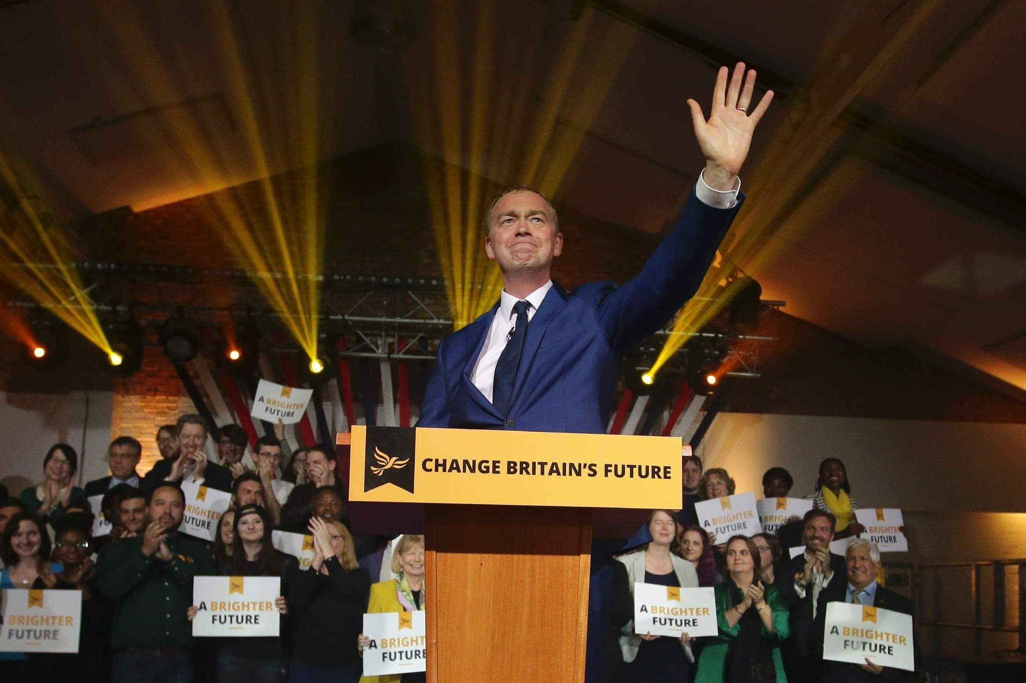 Liberal Democrats leader Tim Farron gestures as he speaks at an event to launch the party's general election manifesto in London on May 17, 2017. (AFP Photo)