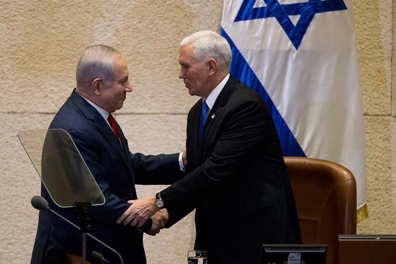Israel's Prime Minister Benjamin Netanyahu, left, shake hands with U.S. Vice President Mike Pence in Israel's parliament in Jerusalem, Jan. 22, 2018. (AP Photo)