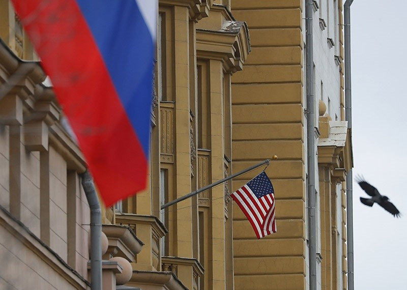 The US flag flies from the main building of the Embassy of the United States of America near a Russian flag (L, front) in Moscow, Russia, 03 April 2018. (EPA Photo)