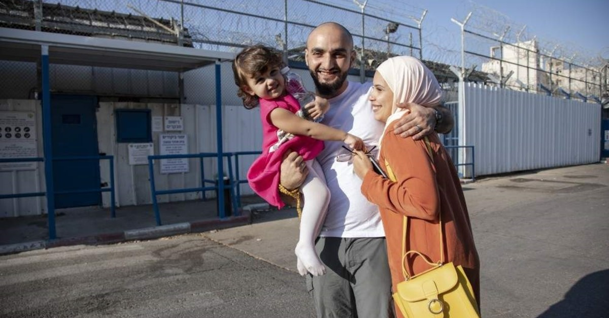 Mustafa al-Kharouf hugs his wife and daughter after his release, Oct. 24, 2019. (AA Photo)