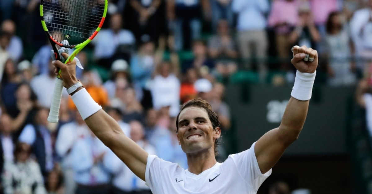 Spain's Rafael Nadal celebrates winning a men's quarterfinal match against United States' Sam Querrey on day nine of the Wimbledon Tennis Championships in London, Wednesday, July 10, 2019. (AP Photo)