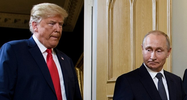 In this file photo taken on July 16, 2018 US President Donald Trump (L) and Russian President Vladimir Putin arrive for a meeting in Helsinki. (AFP Photo)