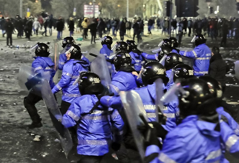 Romanian riot police charge after minor clashes erupted during a protest in Bucharest, Romania on Thursday, Feb. 2, 2017. (AP Photo)