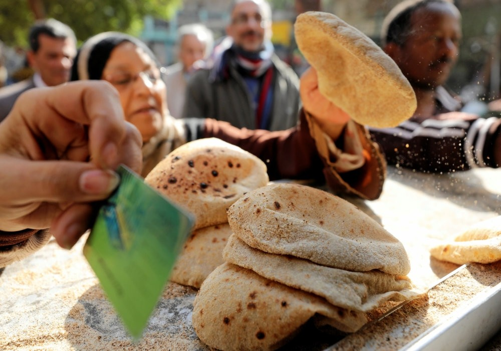Forty years after the Sadat-era bread riots established the subsidy as a political red line, the pita is still offered for just 0.05 Egyptian pounds ($0.0028) per loaf, which today is about one-tenth its free market price.
