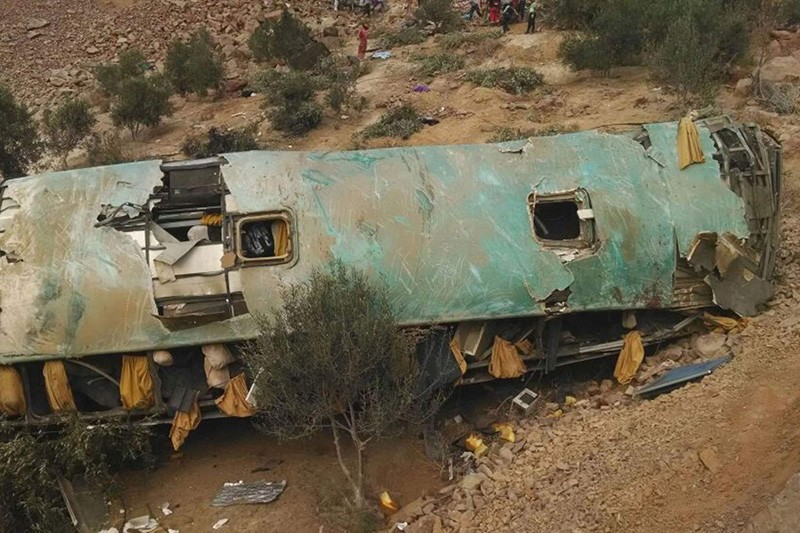 In this photo provided by the government news agency Andina, a crashed bus lays on the bottom of a cliff in Arequipa, Peru, Wednesday, Feb. 21, 2018. (AP Photo)