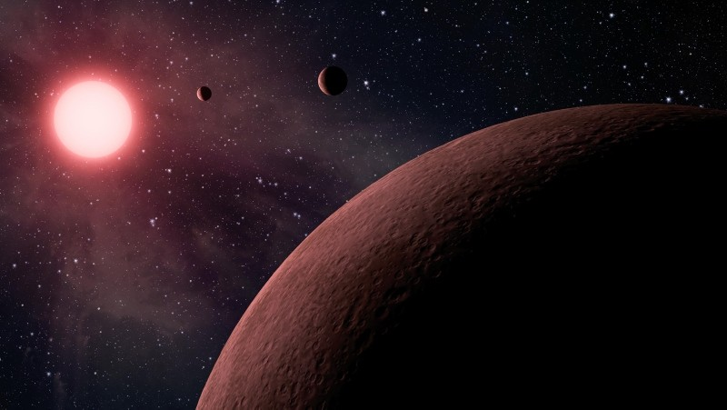 An undated handout photo made available by NASA on June 20, 2017 shows an artist's concept depicting an itsy bitsy planetary system. (EPA Photo)