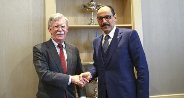 Photo shows U.S. national security adviser John Bolton (L) and Presidential Spokesperson İbrahim Kalın shaking hands after a meeting in Ankara. (AA Photo)