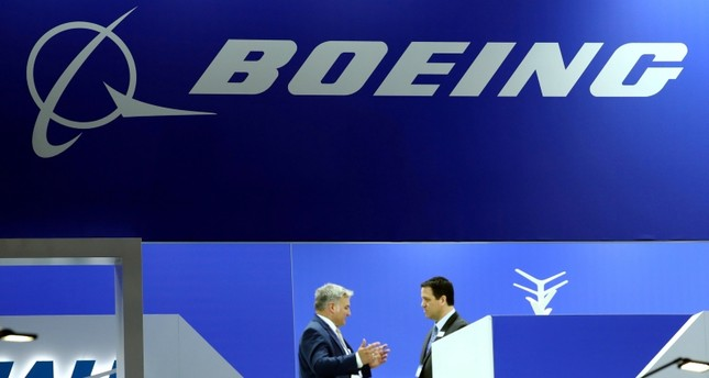 Visitors talk on the Boeing stand during the European Business Aviation Convention & Exhibition (EBACE) at Cointrin Airport in Geneva, Switzerland May 21, 2019. (Reuters Photo)