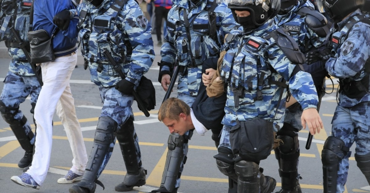 Law enforcement officers detain men after a rally to demand authorities allow opposition candidates to run in the upcoming local election in Moscow, Russia Aug. 10, 2019 (Reuters Photo)