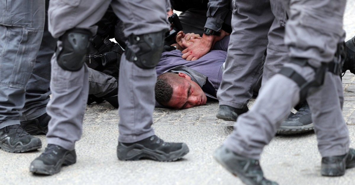 Israeli forces detain a Palestinian during scuffles outside the Al-Aqsa Mosque compound in Jerusalemu2019s Old City, March 12, 2019.