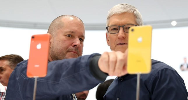In this file photo taken on September 12, 2018 Apple chief design officer Jony Ive (L) and Apple CEO Tim Cook inspect the  iPhone XR during an Apple special event at the Steve Jobs Theatre  in Cupertino, California (AFP Photo)