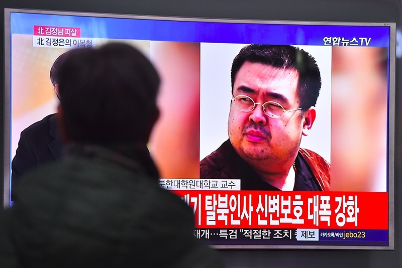 A man watches a television showing news reports of Kim Jong-Nam, the half-brother of Kim Jong-Un, in Seoul on Feb 14, 2017. (AFP Photo)