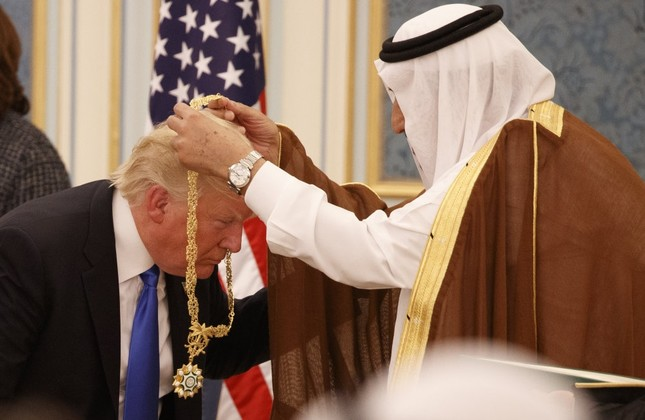 Saudi King Salman presents President Trump with the highest civilian honor, the Collar of Abdulaziz al-Saud, at the Royal Court Palace, Riyadh, Saudi Arabia, May 20, 2017. (AP Photo)
