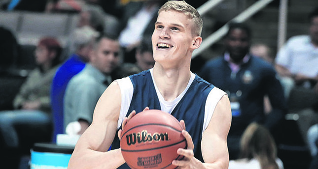 Arizona forward Lauri Markkanen smiles during practice in San Jose, Calif. Markkanen is a lottery pick in NBA draft after one season at Arizona.