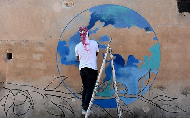 Turkish graffiti artists create anti war murals in syria daily sabah the world map above a bloody olive branch can best illustrate the tragedy in syria gumiabroncs Choice Image